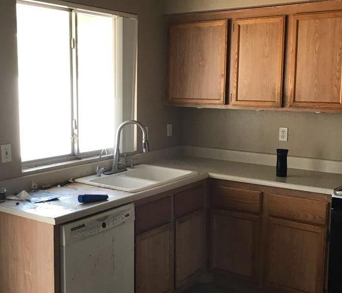 Kitchen with brown cabinets and hidden water damage.