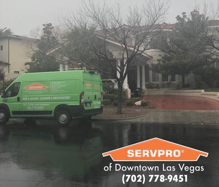 SERVPRO van parked outside a home.