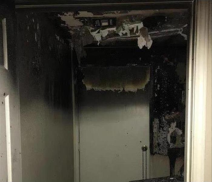 door, burned, ceiling collapsed due to fire damage