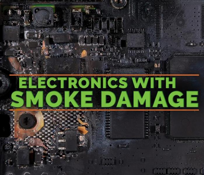 Background of an electronic damaged by fire with the LOGO of SERVPRO