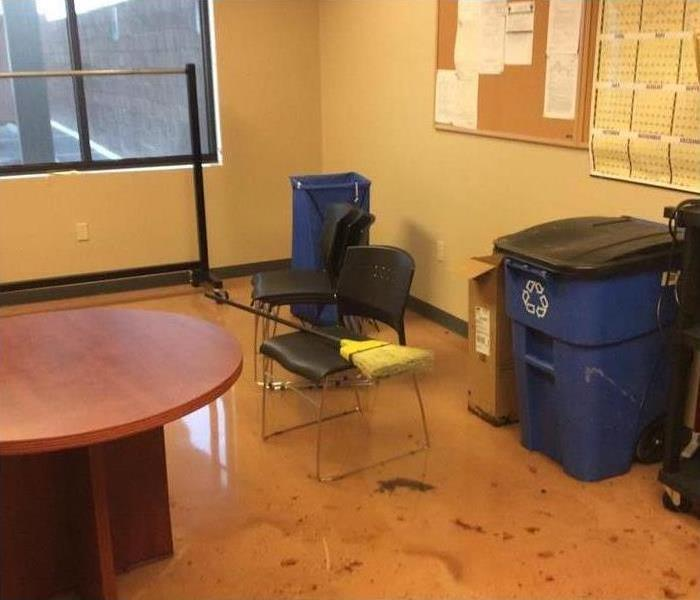 office, sewer water standing, trash can, chairs, round table